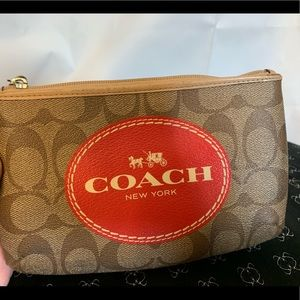 Coach horse and carriage signature wristlet